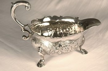 A silver George 11 sauce boat