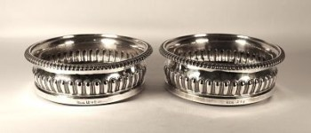 A pair of George 111 antique silver wine coasters