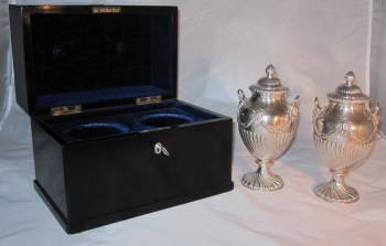 A pair of George 111 silver tea caddies in an ebonised box