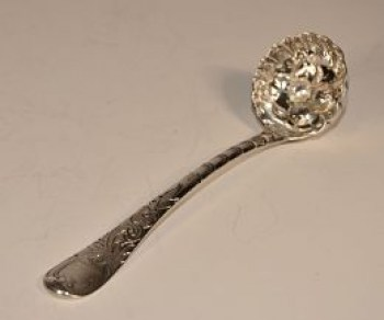 A Queen Anne silver sauce ladle SOLD