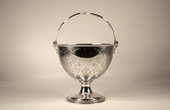 A Victorian antique silver sugar basket (swing-handled)