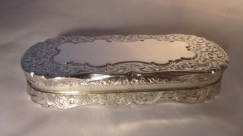 A Victorian silver shaped oval snuff box.